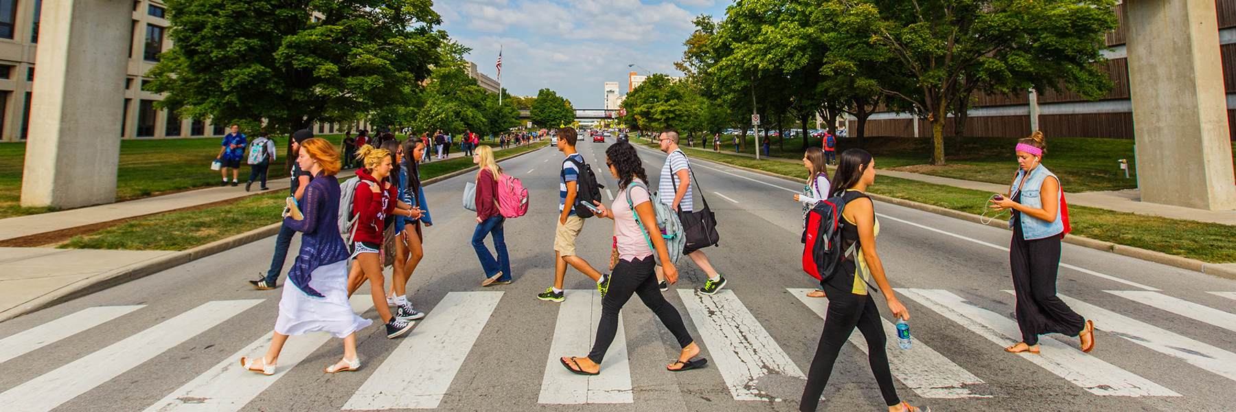 Students on campus walking across Michigan Street.
